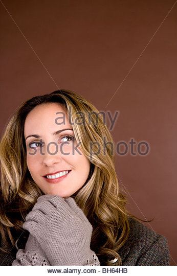 Portrait of a mid adult woman wearing autumnal clothes - Stock Image