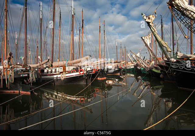 The Netherlands, Volendam, traditional sailing ships in harbour. - Stock Image
