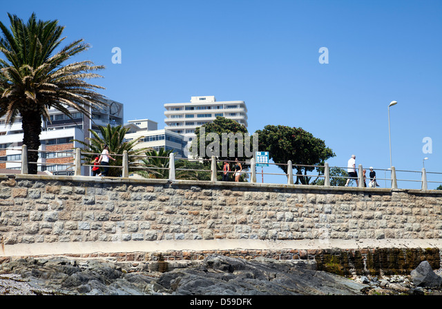 People walking along Promenade in sea Point - Cape Town - South Africa - Stock Image