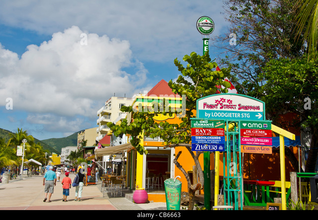 A row of colorful shops and signs  on Front Street in Philipsburg, St Maarten - Stock Image