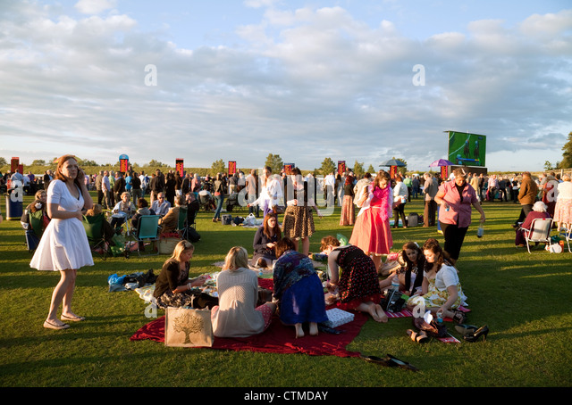 Crowds enjoying the horse racing at Newmarket Racecourse Suffolk UK - Stock Image