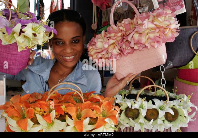 Sint Maarten Philipsburg Dutch duty free shopping souvenirs Black female flowers handbags - Stock Image
