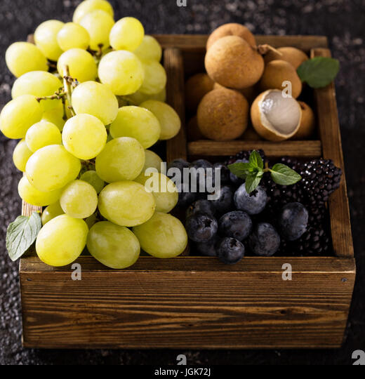 Fresh fruits in wooden box - Stock Image