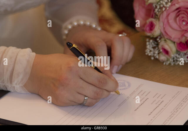 The Signature Of The Newlyweds At The Wedding Sealed The Marriage Covenant - Stock Image