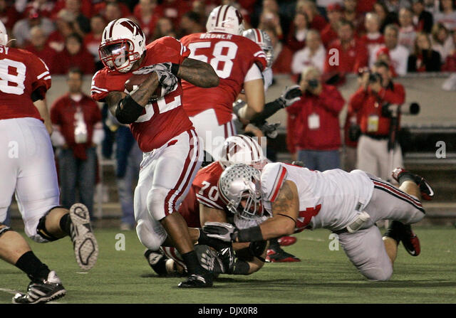 Oct. 16, 2010 - Madison, Wisconsin, United States of America - Wisconsin RB John Clay (32) is tripped up by Ohio - Stock Image
