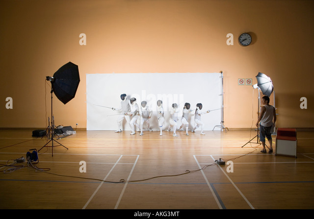 Group of people fencing - Stock Image