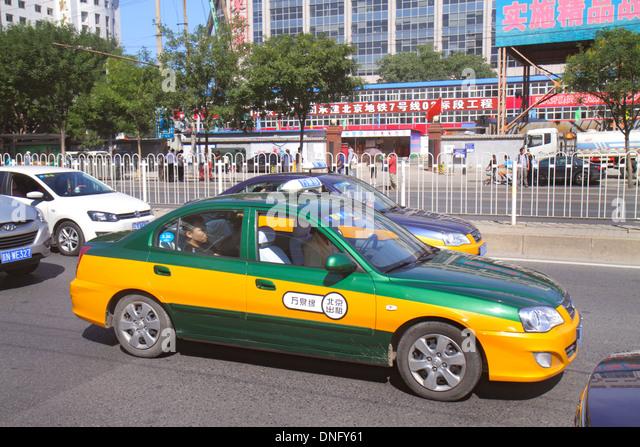 Beijing China Xicheng District Guang An Men Nei Da Jie Guanganmen Outer Street traffic taxi cab - Stock Image