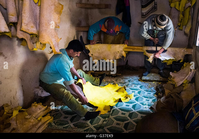 Fez, Morocco - April 11, 2016: Tree man working in a tannery in the city of Fez in Morocco. - Stock-Bilder