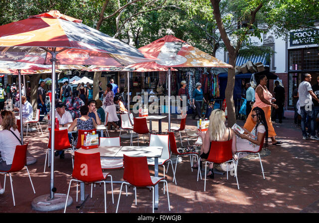 Cape Town South Africa African City Centre center St. Saint Georges Mall alfresco restaurant tables umbrellas - Stock Image