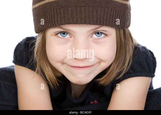 Shot of a Cute Blue Eyed Child with a Cheeky Grin - Stock Image