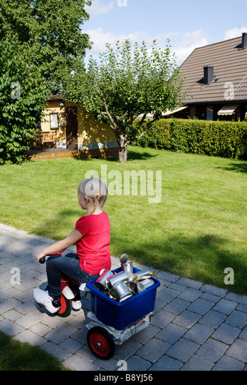 A girl with recycling objects on her bicycle Sweden. - Stock Image