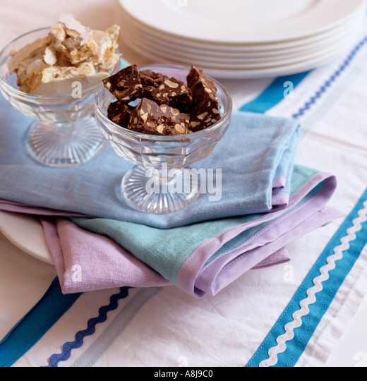 Chocolate nougat in glass dishes - Stock Image