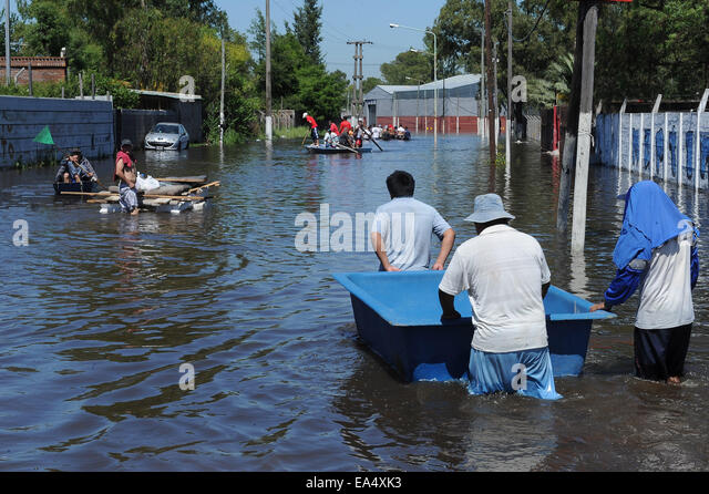 Buenos Aires, Argentina. 6th Nov, 2014. Residents walk through the flood after heavy rain, in Buenos Aires Province, - Stock Image