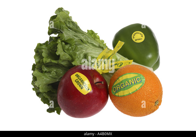 Fruits and Vegetables with Organic Labels cut out on white background - Stock Image