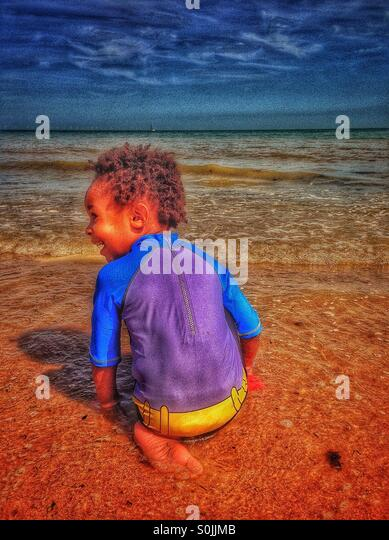 The boy at the beach. - Stock Image