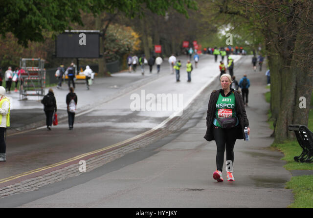 London, UK 24 April 2016. Andy walks down Greenwich park looking for her fellow NSPCC runners. Three quarters of - Stock Image