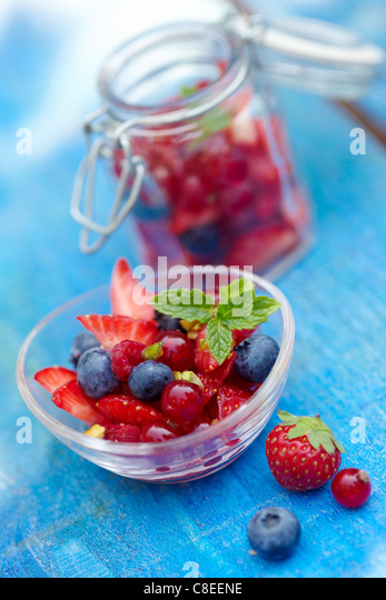 Bowl and jar of summer fruit - Stock Image