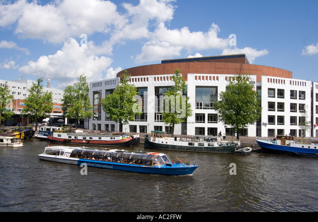 Amsterdam opera house canal boat - Stock Image