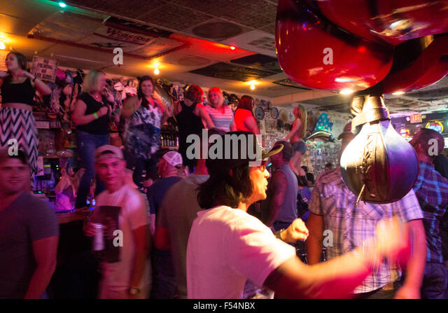 women dance on bar and men use punch ball in bikers bar in downtown Las Vegas Nevada USA - Stock Image