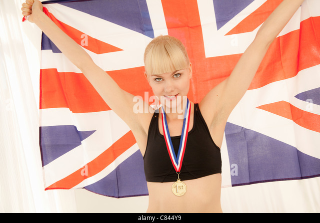 Athlete with medal and Union Jack flag - Stock Image