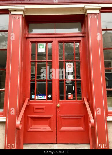 Red doors on a Georgian style red shopfront. - Stock Image