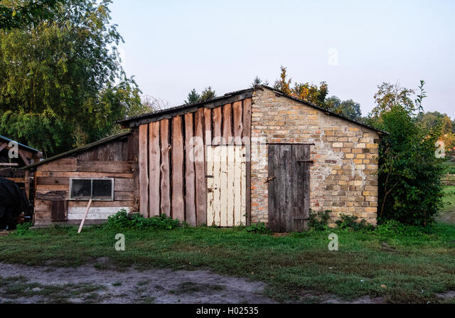 Old farm buildings at Gut Boltenhof Hotel & farm, Brandenburg, Germany - Stock Image