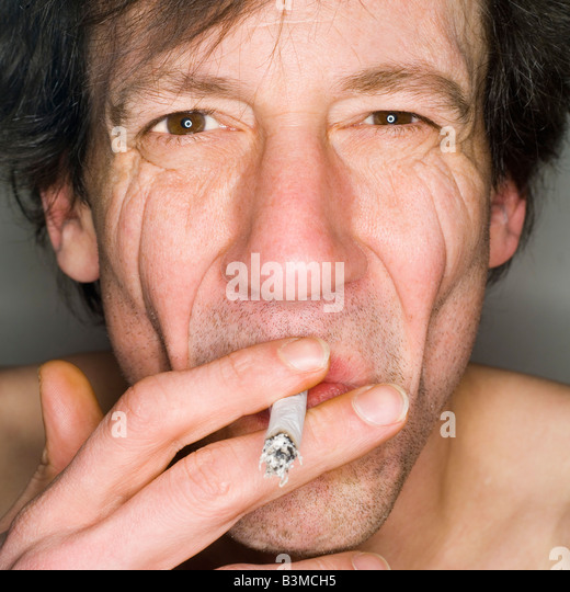 Man smoking, close-up, portrait - Stock Image