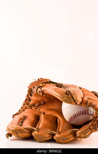 Isolated baseball glove and ball - Stock Image