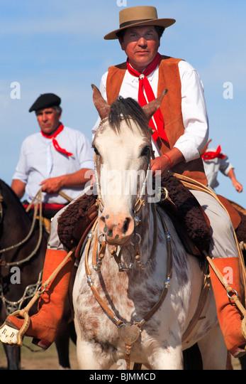 Paisanos (modern gauchos) with horses at San Antonio de Areco Gaucho Festival. (Fiesta de la Tradicion/ Tradition - Stock Image