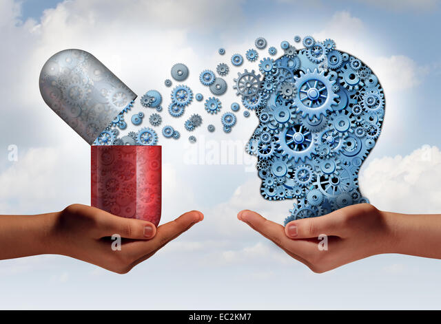 Brain medicine mental health care concept as hands holding an open pill capsule releasing gears to a human head - Stock Image