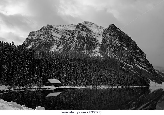 Canada lake house winter stock photos canada lake house for Ice fishing cabins alberta