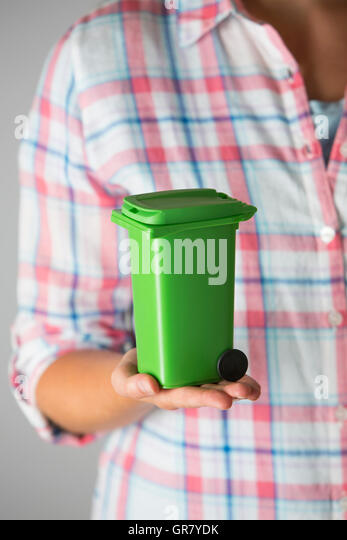 Close Up Of Woman Holding Model Recycling Bin - Stock Image