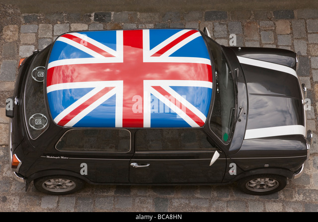 Europe Union Jack painted on roof of a black Mini car from above - Stock Image