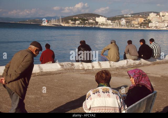 Turkey Aegean Coast Kusadasi Harbor residents promenade in local park - Stock Image