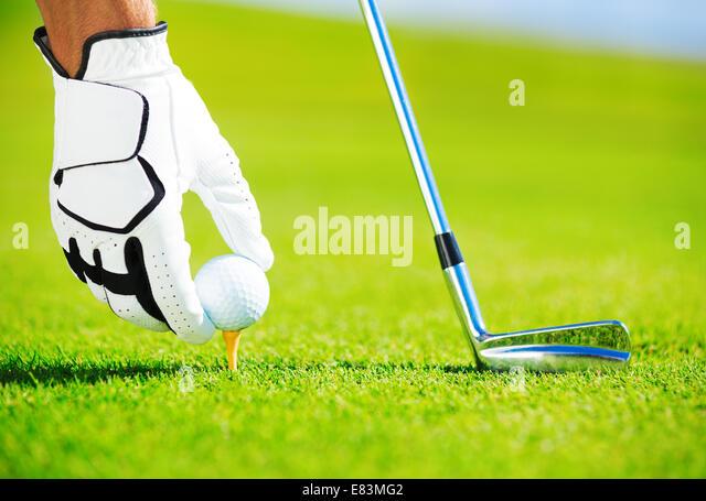 Man Placing Golf Ball on the Tee, Close up Detail - Stock-Bilder