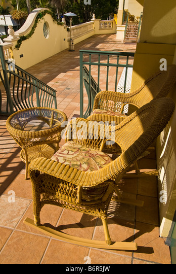 wicker chairs Inn on Fifth terrace balcony porch Old Naples Florida fl popular hotel - Stock Image