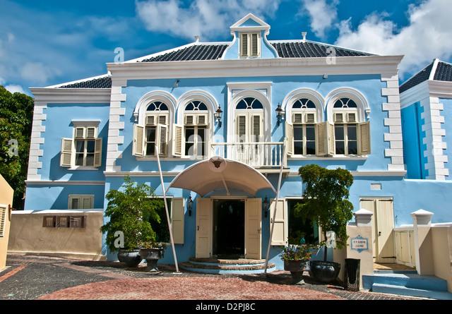 Hotel Kura Hulanda Spa and Casino resort village, blue building in Dutch architecture, Willemstad, Curacao - Stock Image