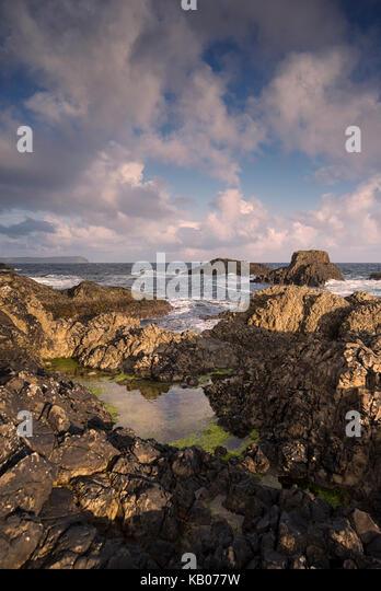 Rocky coastline near Ballintoy Harbor on the Causeway Coast in County Antrim, Northern Ireland - Stock Image