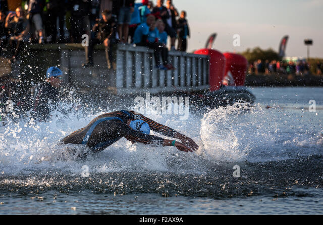 Participants of the Ironman Triathlon starting the race in the surf, Amager Strandpark, Copenhagen, Denmark - Stock-Bilder