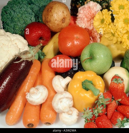 Vegetable fruit flowers in a still life arrangement - Stock Image