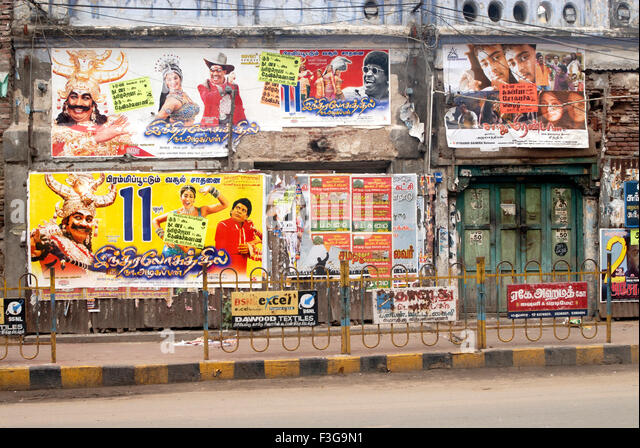 Colourful posters of movies of tamil film industry ; Madurai ; Tamil Nadu ; India - Stock Image