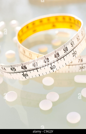 Diet pills, conceptual image. - Stock Image