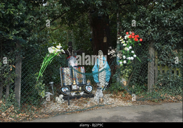Roadside Catholic shrine to your person killed in car accident. Sydenham Hill South London UK - Stock Image