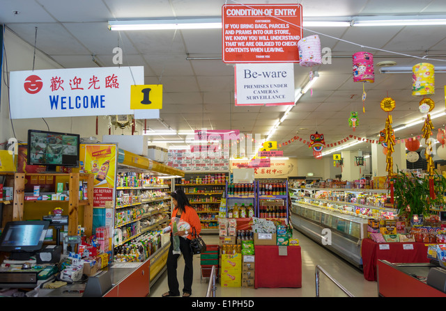 Brisbane Australia Queensland Fortitude Valley Chinatown Brunswick Street grocery store supermarket Asian woman - Stock Image