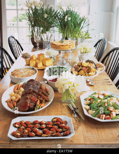 table set with large meal - Stock-Bilder