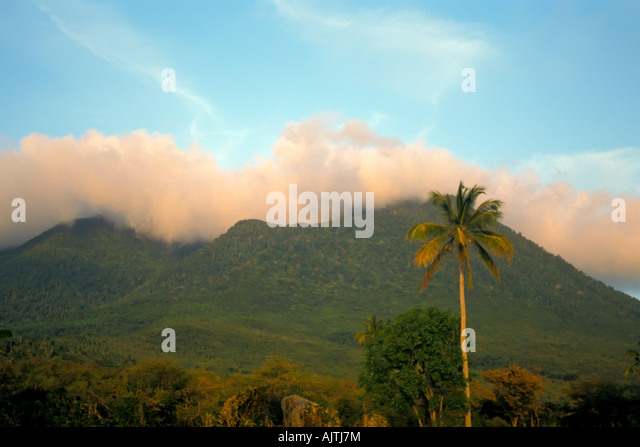 Mount Nevis peak, green volcano crater, brooding summit clouds, clear day, Island of Nevis, St Kitts and Nevis, - Stock Image