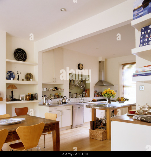 a contemporary kitchen-dining area in a London townhouse - Stock Image