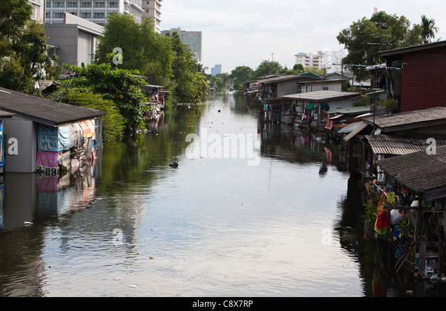 Bangkok, khlong (canal) Bang Khen in Bang Khen district overflows as nearby residents have their houses flooded. - Stock Image