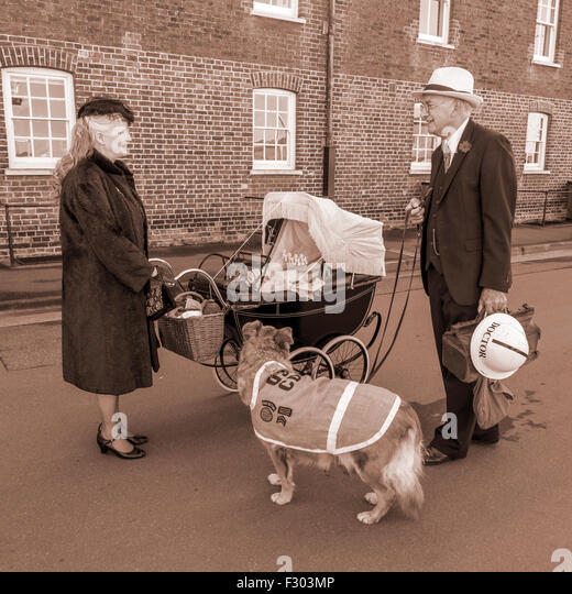 1940s Re-enactment Re-enactors Doctor with Wife and Rescue Dog - Stock Image