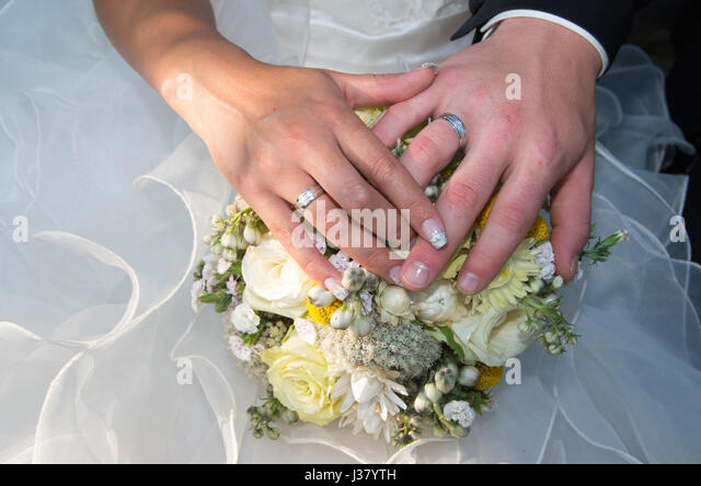 Newlyweds. Commitment, happiness and love... - Stock Image